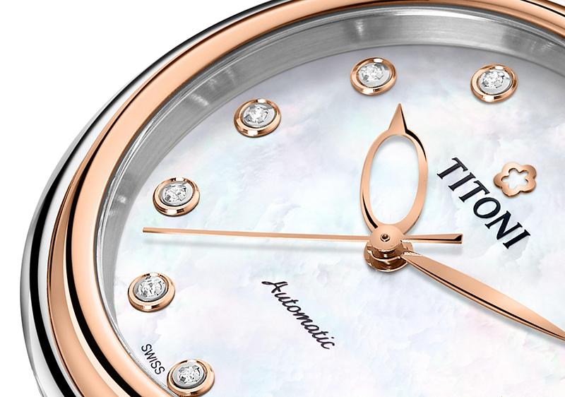圖1. 錶盤上輕巧鑲嵌的寶石時標,妝點著女性柔美的優雅 (1)