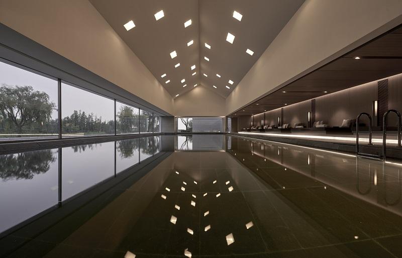 Alila Wuzhen - Facilities - Indoor Swimming Pool at Sunset